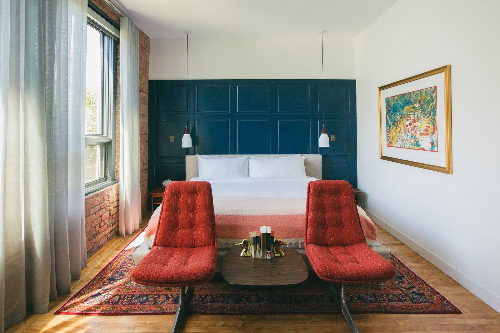 Bedroom, Ceiling Lighting, Medium Hardwood Floor, Bed, Pendant Lighting, and Chair Bellow Room  Best Photos from The Publishing House Bed & Breakfast
