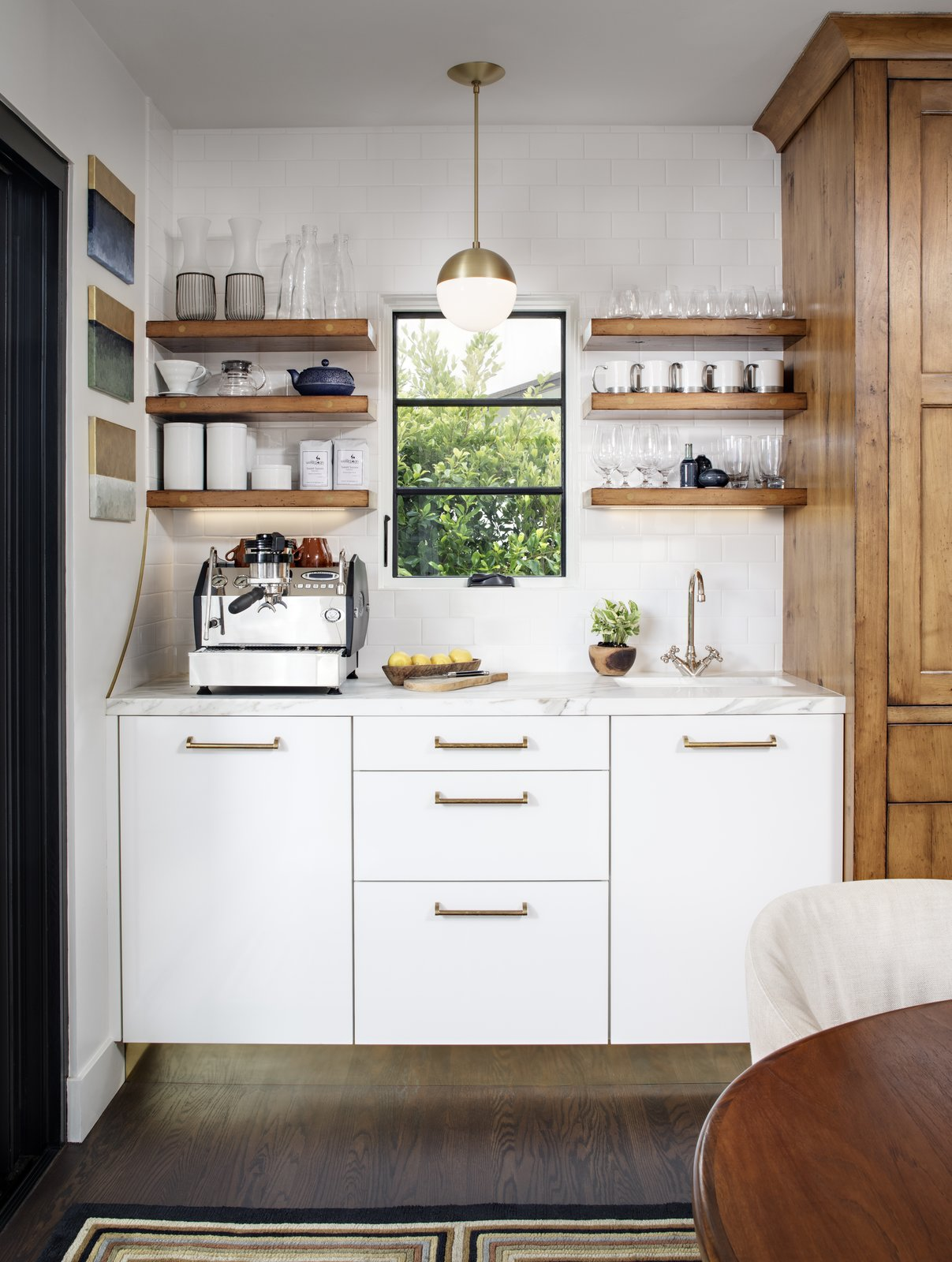 Kitchen, Marble, White, Wood, Medium Hardwood, Subway Tile, Pendant, Dishwasher, and Undermount Coffee Bar  Best Kitchen Subway Tile Wood White Photos from Mission Hills Modern