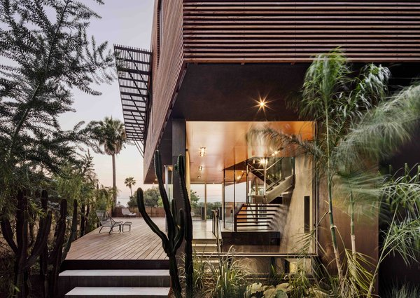 The exterior deck seamlessly transitions into the interior of the home.