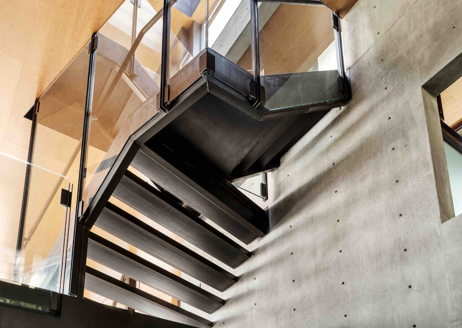 Staircase, Metal Tread, Concrete Tread, and Metal Railing Stairs were custom-fabricated and welded on-site during construction.  Skyline Residence by ShubinDonaldson