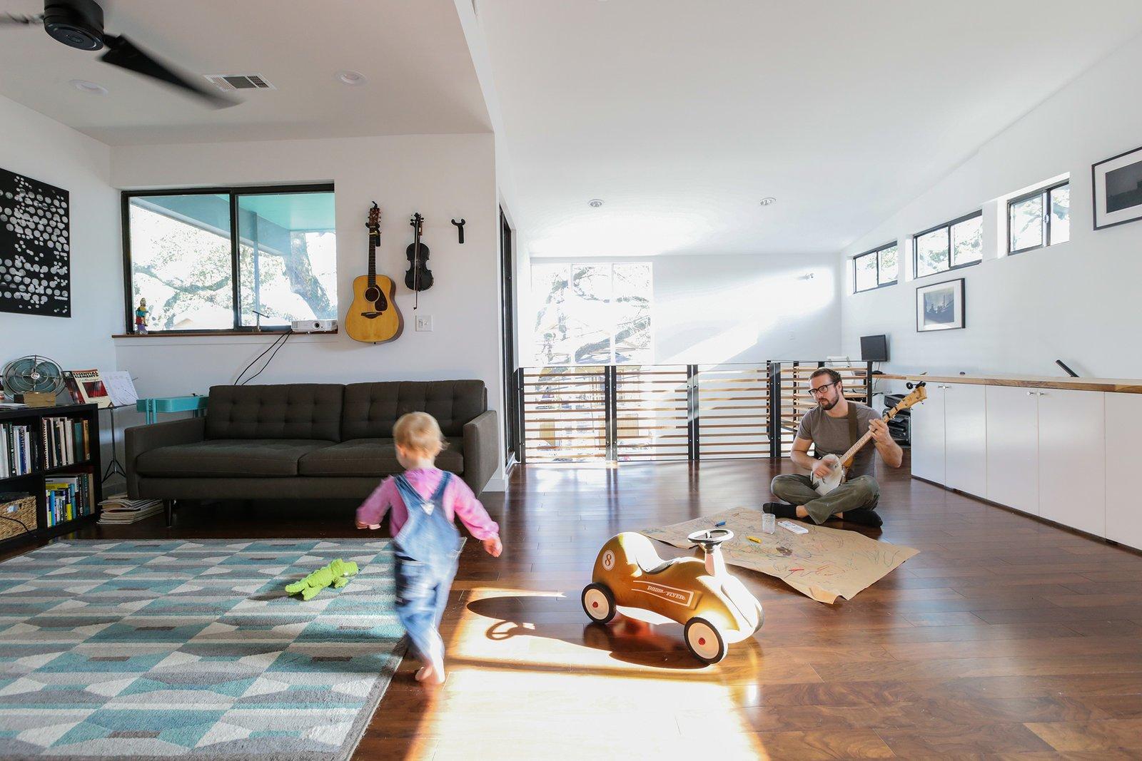 Living Room, Ceiling Lighting, Sofa, and Dark Hardwood Floor Second floor living spaces  Dorgenois