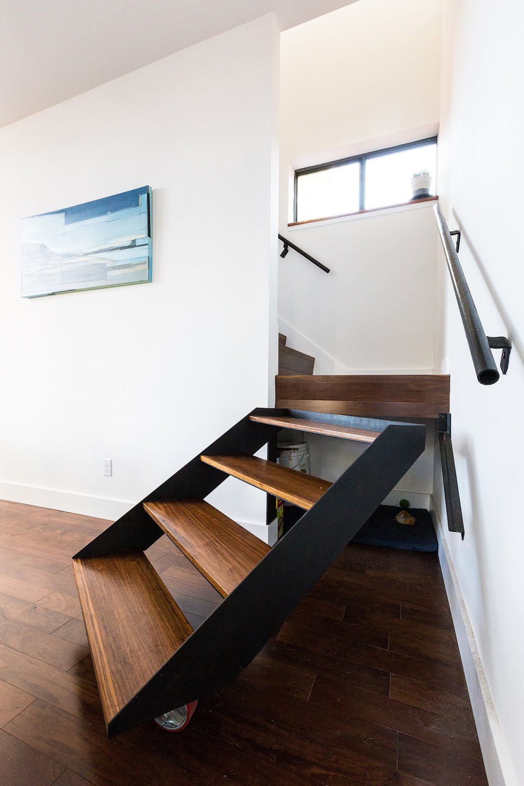 Storage Room and Under Stairs Storage Type The architects, owners of a New Orleans design build firm, fabricated a pivoting stair to allow access to under stair storage. Painting by Tiffany Lin.  Dorgenois