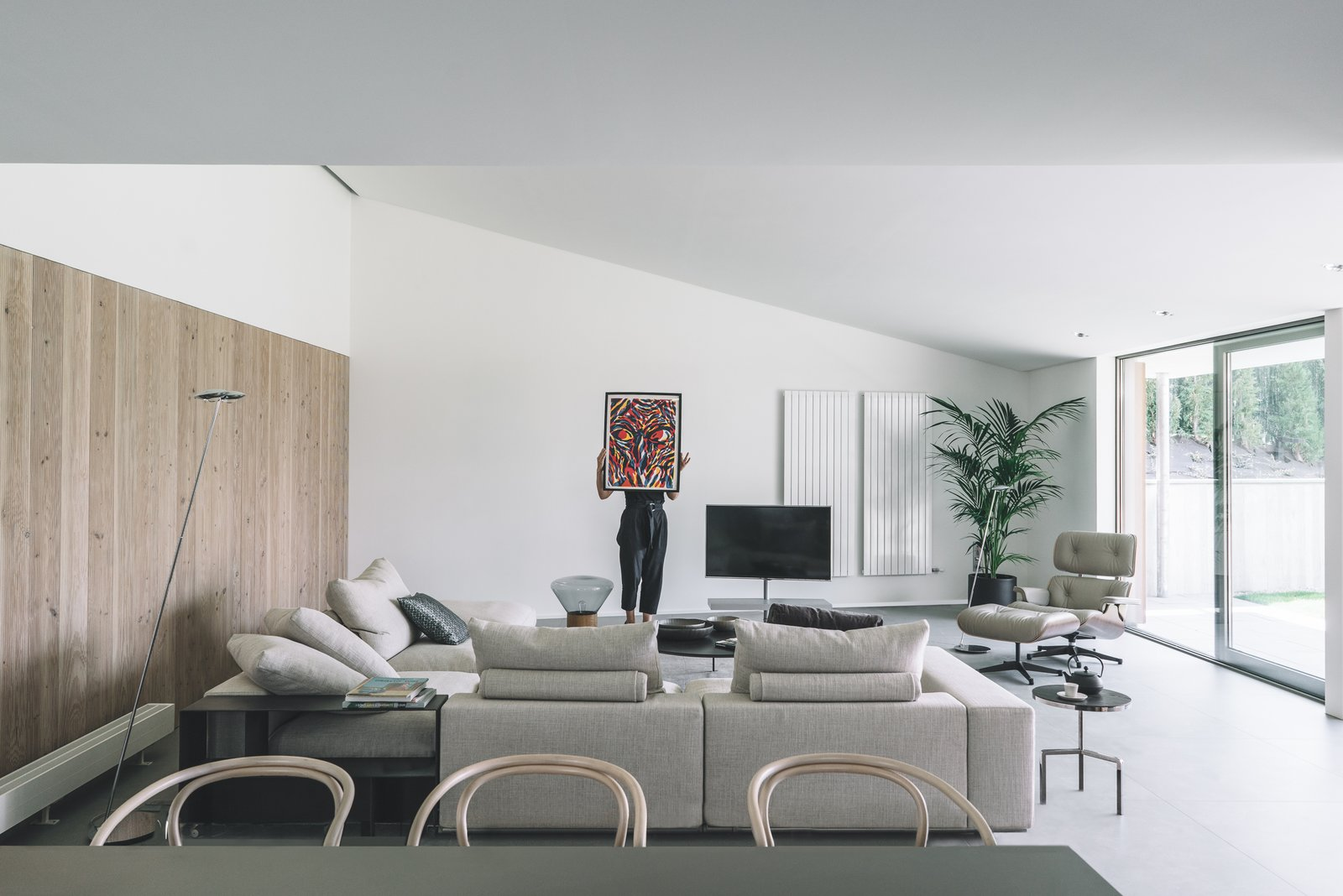 Chair, Coffee Tables, Wall Lighting, Ottomans, Sofa, End Tables, Porcelain Tile Floor, and Kitchen Interior view: Living Room  The Öcher House by MLMR Architecture Consultancy
