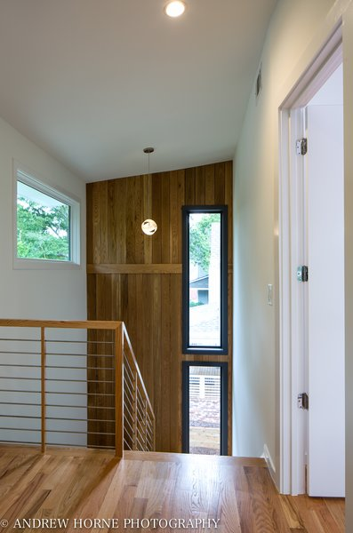 Stainless steel stair and White Oak accent wall