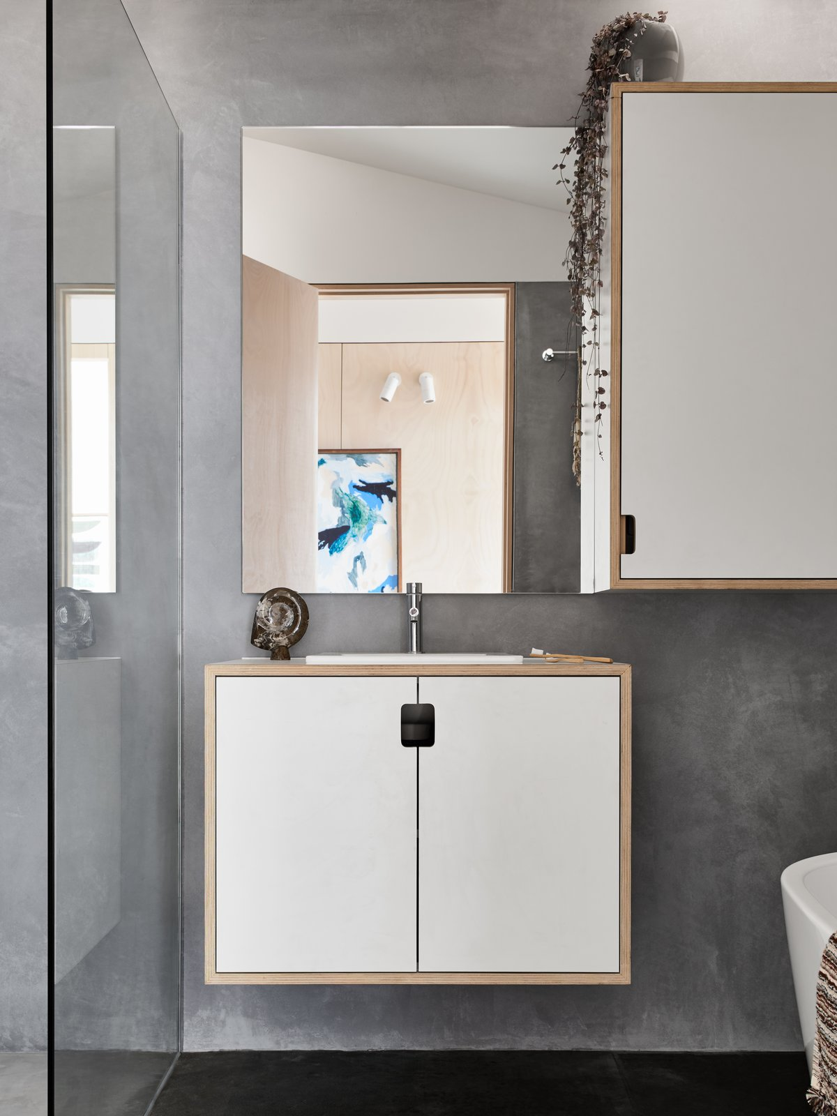 Bath Room, Concrete Floor, Wood Counter, Drop In Sink, Concrete Wall, and One Piece Toilet Main bathroom featuring natural, non-toxic marrakech render on walls and wet areas.  The 10 Star Home by The Sociable Weaver