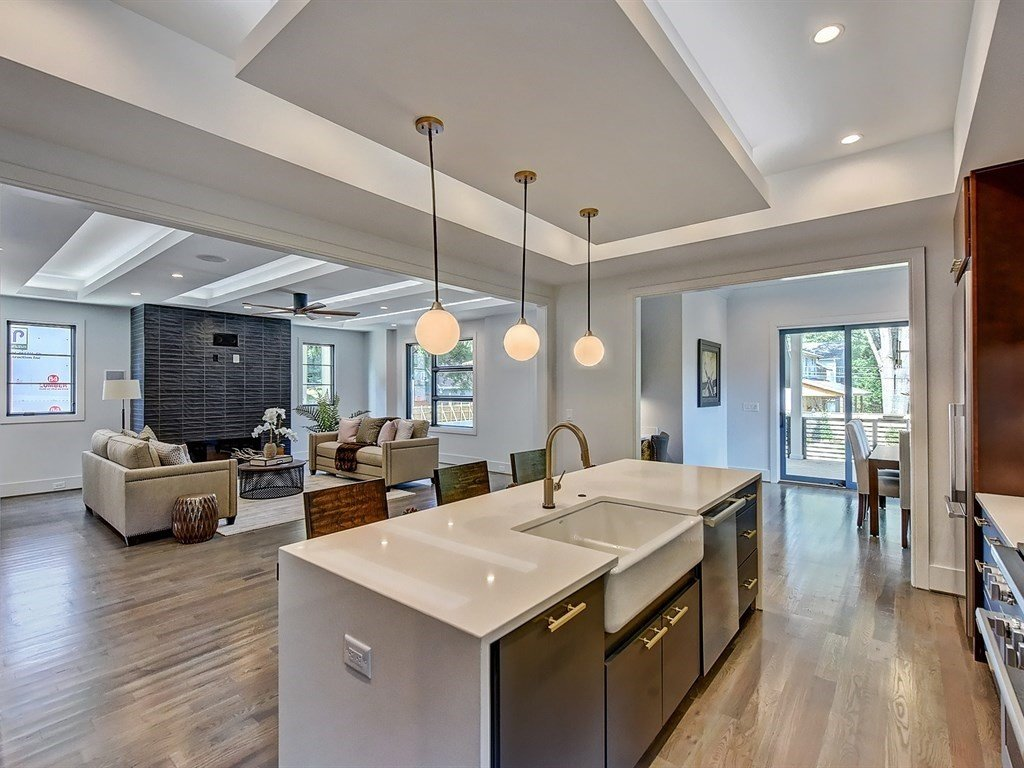 Kitchen, Wood Cabinet, Light Hardwood Floor, Accent Lighting, Undermount Sink, Engineered Quartz Counter, Glass Tile Backsplashe, and Ceiling Lighting Open floorplan  Contemporary Craftsman Home