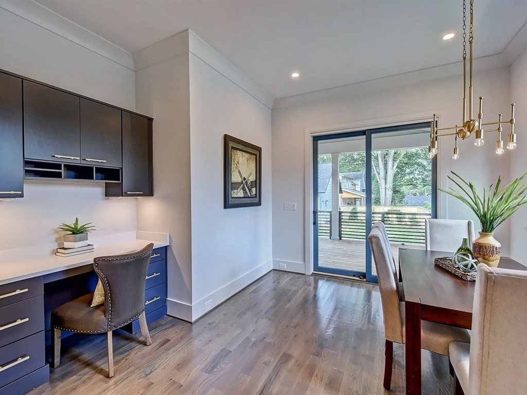 Interior, Sliding Door Type, Wood, and Kitchen Breakfast room off of kitchen with built-in desk and access to covered porch  Contemporary Craftsman Home