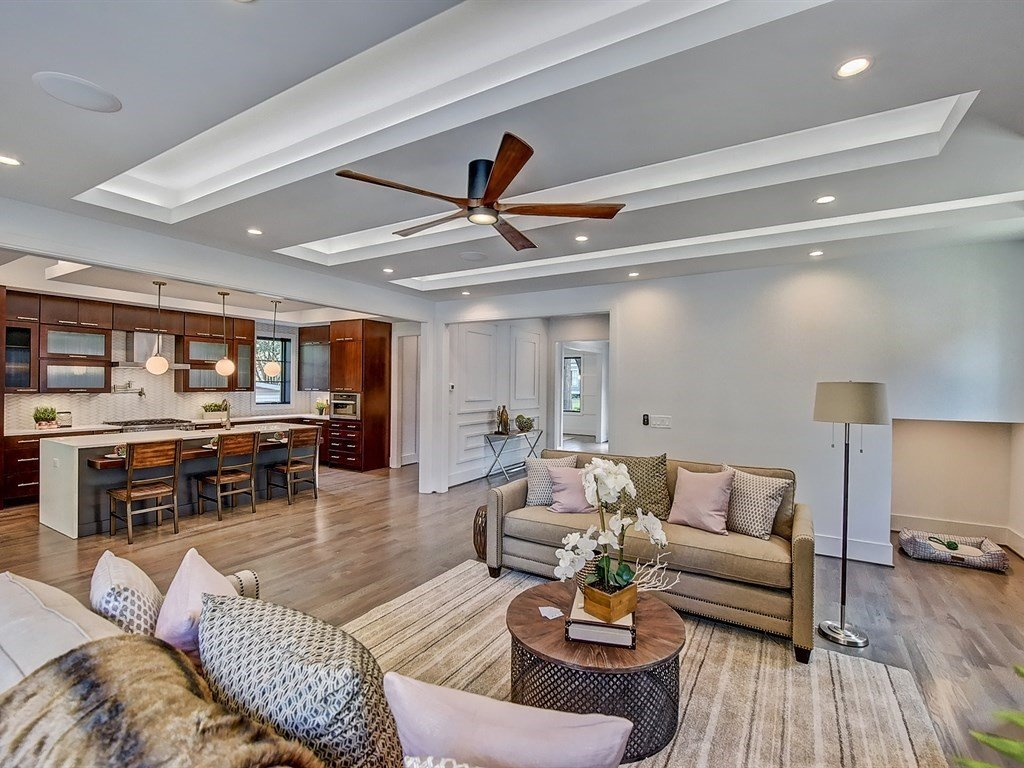 Living Room, Accent Lighting, Recessed Lighting, Light Hardwood Floor, Sofa, and Console Tables Living room has dog nook under the stairs  Contemporary Craftsman Home