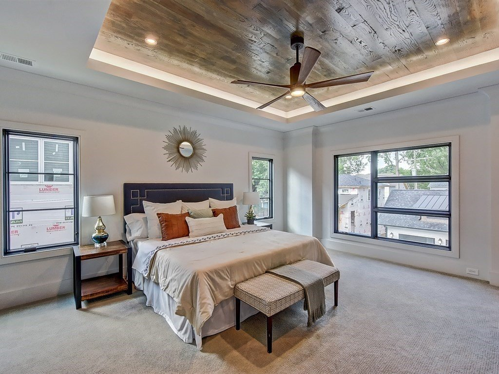 Bed, Ceiling Lighting, Night Stands, Recessed Lighting, Accent Lighting, Carpet Floor, Windows, Casement Window Type, and Metal Master bedroom with wood inlayed tray ceiling and LED uplighting  Contemporary Craftsman Home