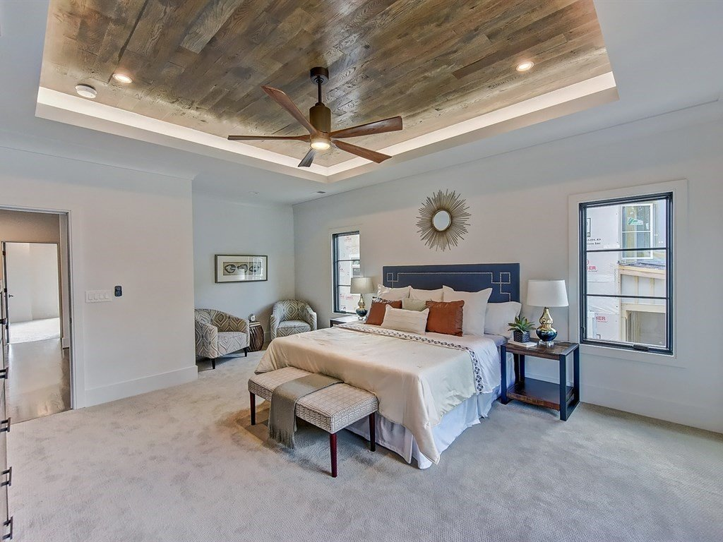Bedroom, Night Stands, Dresser, Ceiling Lighting, Bed, Accent Lighting, Recessed Lighting, and Carpet Floor Sitting area in master bedroom  Contemporary Craftsman Home