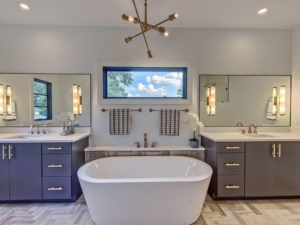 Bath Room, Undermount Sink, Marble Floor, Freestanding Tub, Soaking Tub, Recessed Lighting, Engineered Quartz Counter, and Accent Lighting Master bathroom with marble herringbone floor  Contemporary Craftsman Home