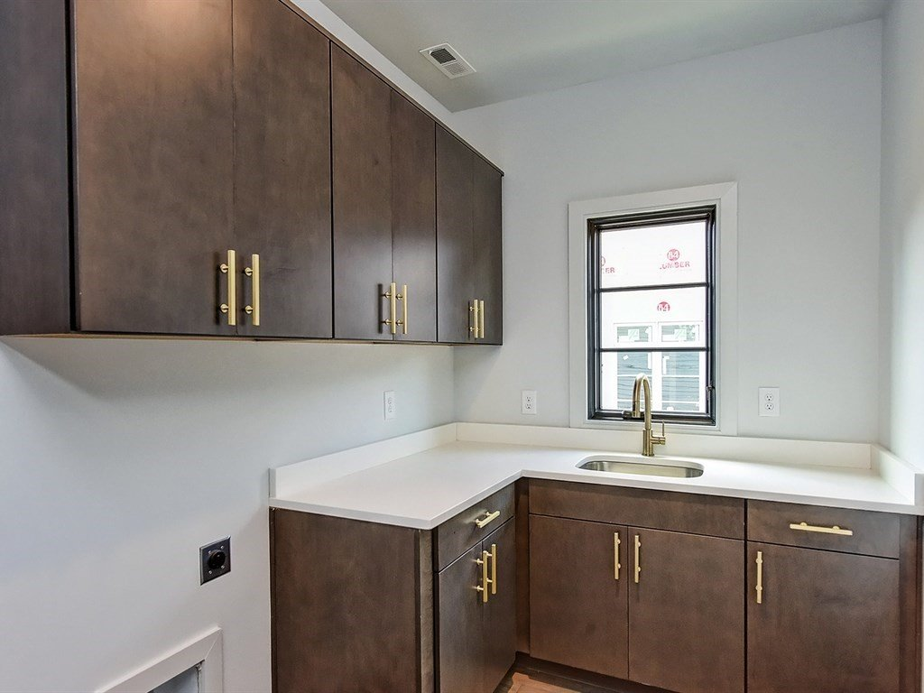 Laundry Room, Wood Cabinet, Engineered Quartz Counter, and Side-by-Side Laundry room  Contemporary Craftsman Home