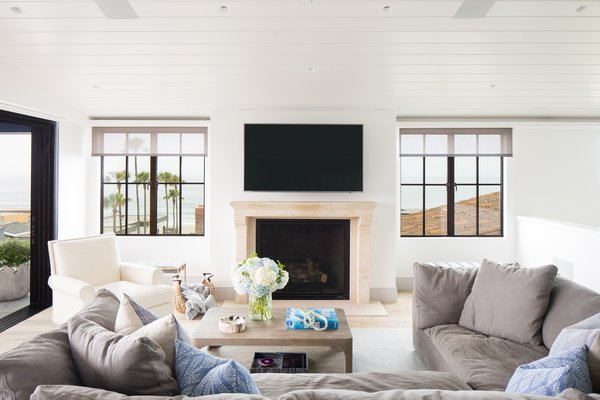 Looking west, this home catches a glimpse of the Manhattan Beach shoreline, through the traditional steel windows.