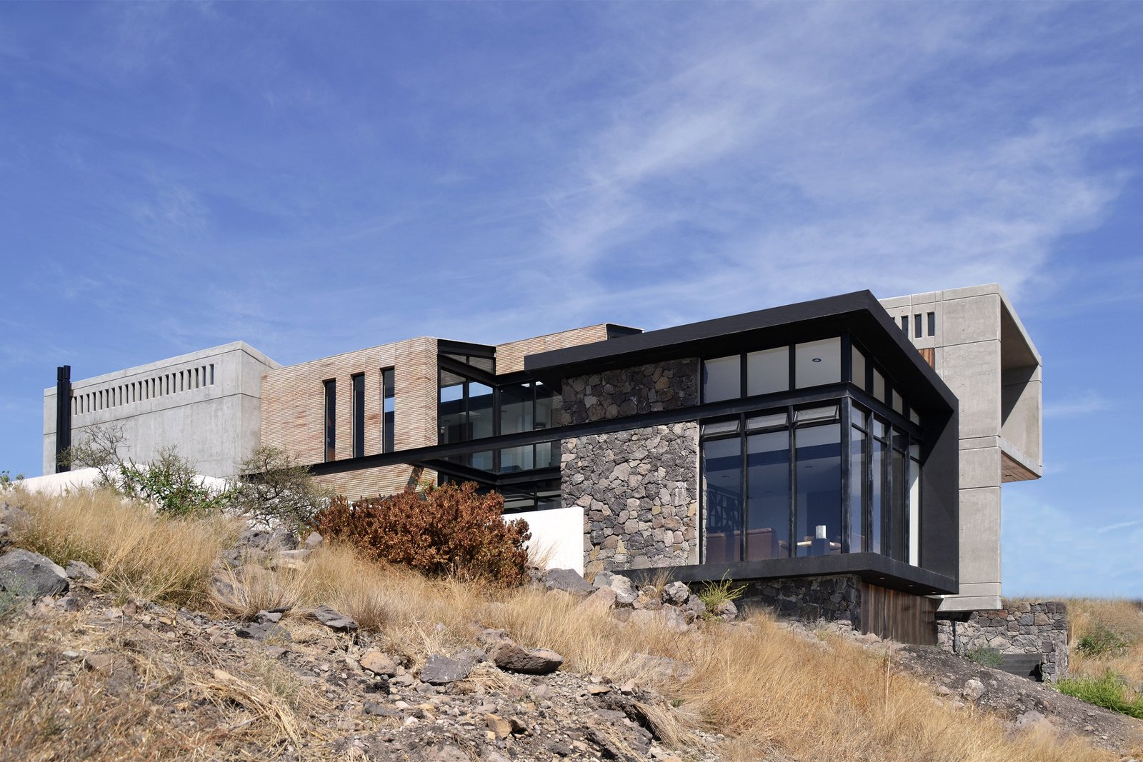 Outdoor, Front Yard, Grass, and Hardscapes Southeast Facade  Casa AB by e|arquitectos
