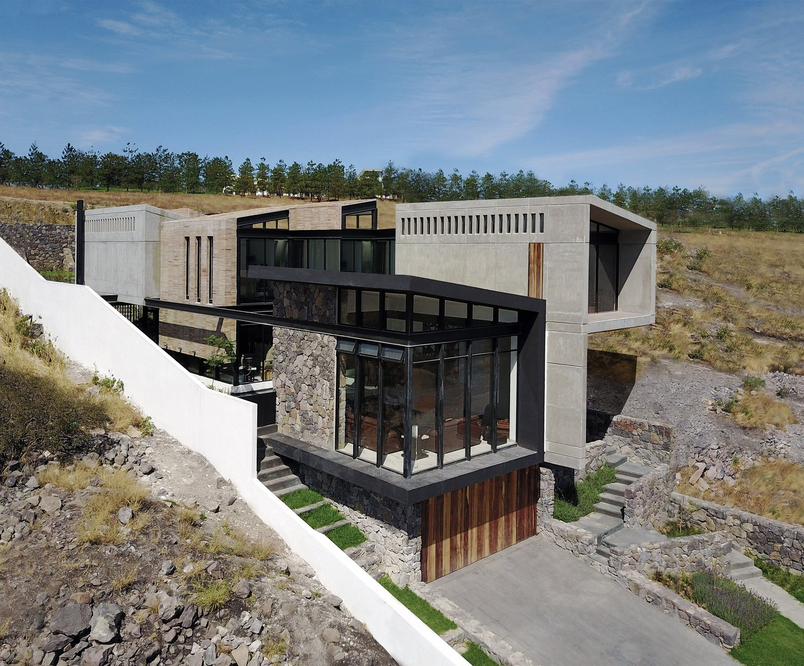 Outdoor, Grass, Front Yard, and Field Aerial View - Southeat Facade  Casa AB by e arquitectos