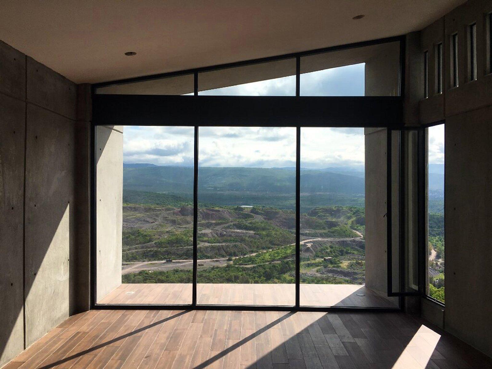 Bedroom, Medium Hardwood Floor, Concrete Floor, and Porcelain Tile Floor Main Bedroom  Casa AB by e|arquitectos