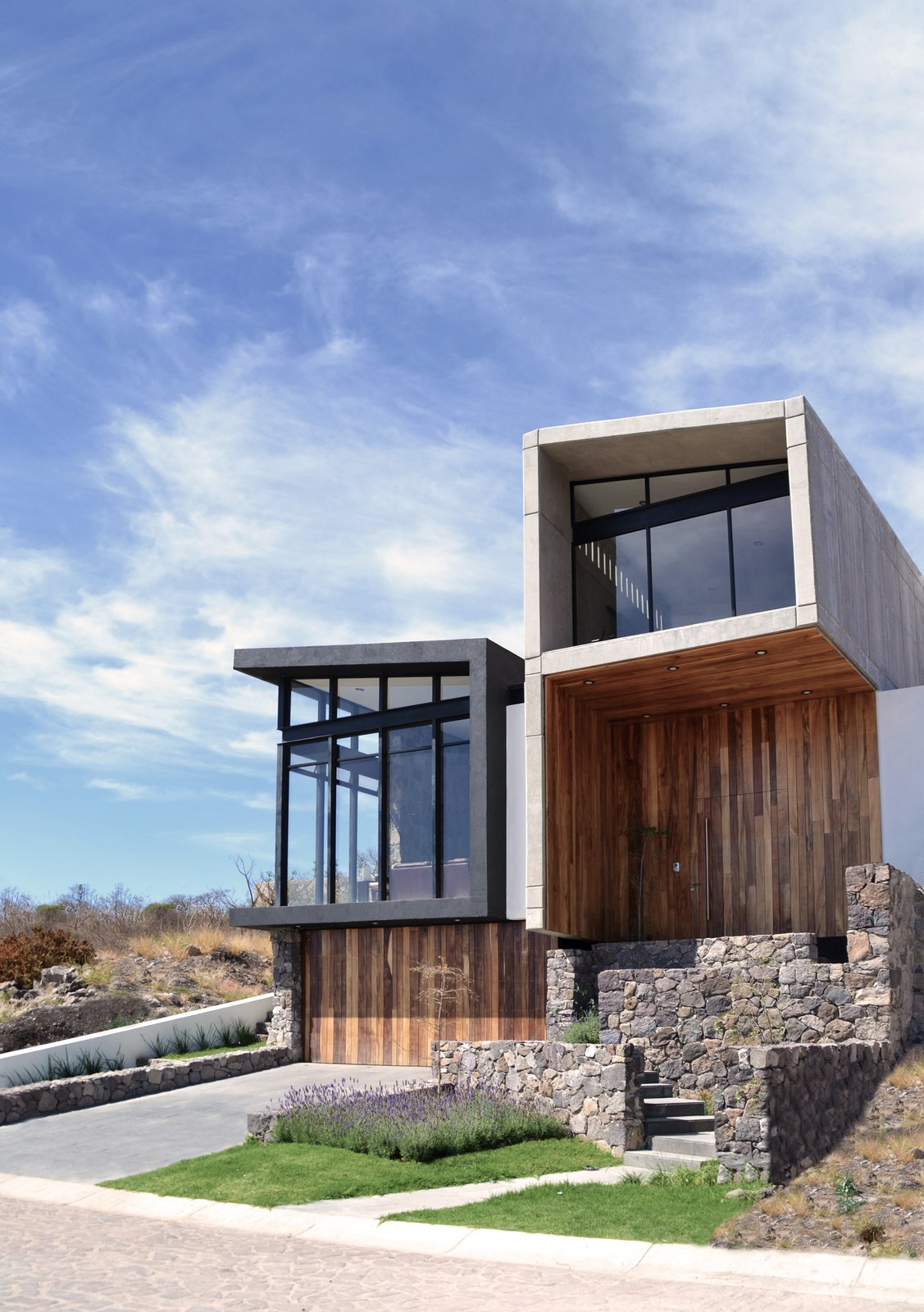 Exterior, Wood Siding Material, Metal Siding Material, and House Building Type East Facade  Casa AB by e|arquitectos