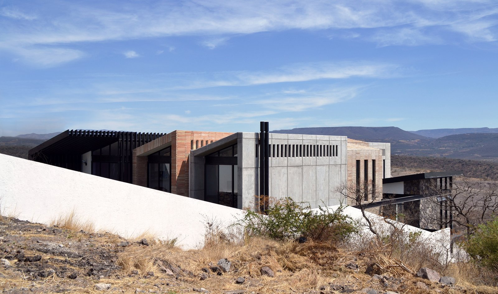 Outdoor, Grass, Hardscapes, and Slope Southwest Facade  Casa AB by e|arquitectos