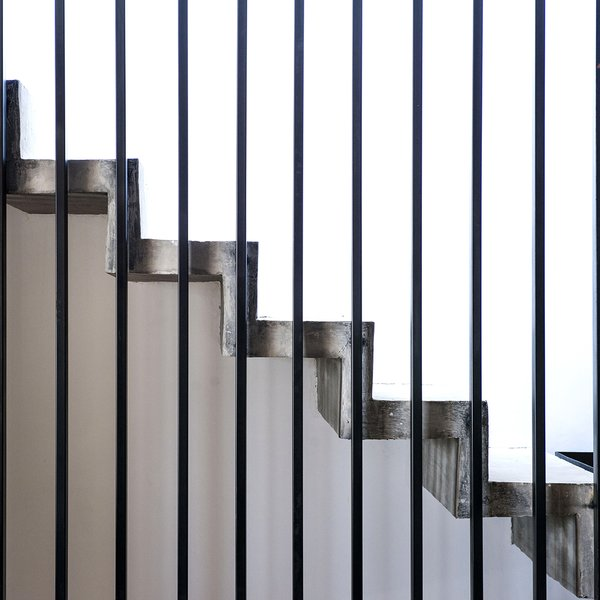 Staircase, Metal Tread, Concrete Tread, and Metal Railing Detail - Stairs and Handrail  Casa MA by e|arquitectos
