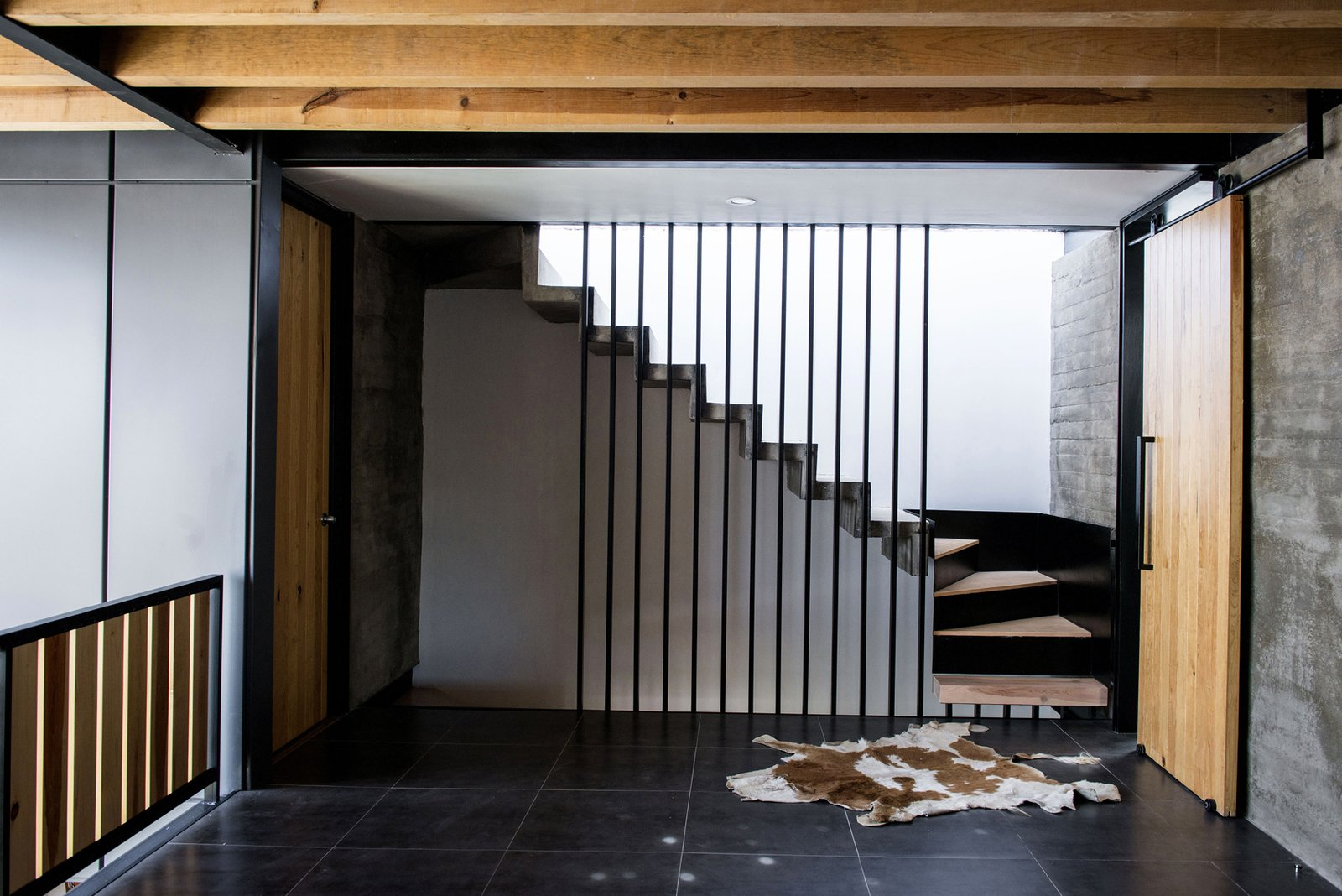 Staircase, Concrete Tread, Metal Tread, Metal Railing, and Wood Tread TV Room and Stairs  Casa MA by e|arquitectos