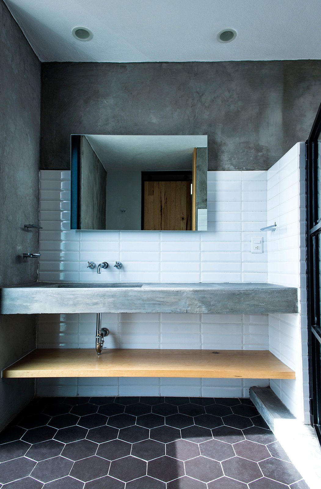 Bath Room, Concrete Counter, Undermount Sink, Ceramic Tile Floor, and Subway Tile Wall Main Bathroom  Casa MA by e|arquitectos