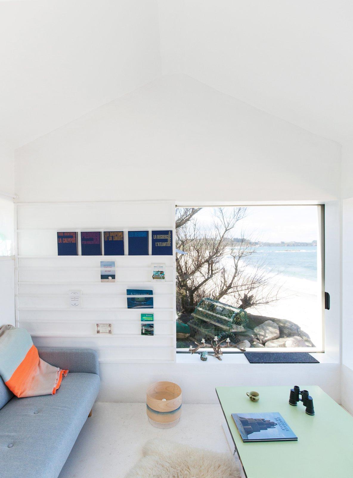 Living Room, Sofa, Bookcase, and Concrete Floor @aubry.guillaume  Viking Seaside Summer Cabin