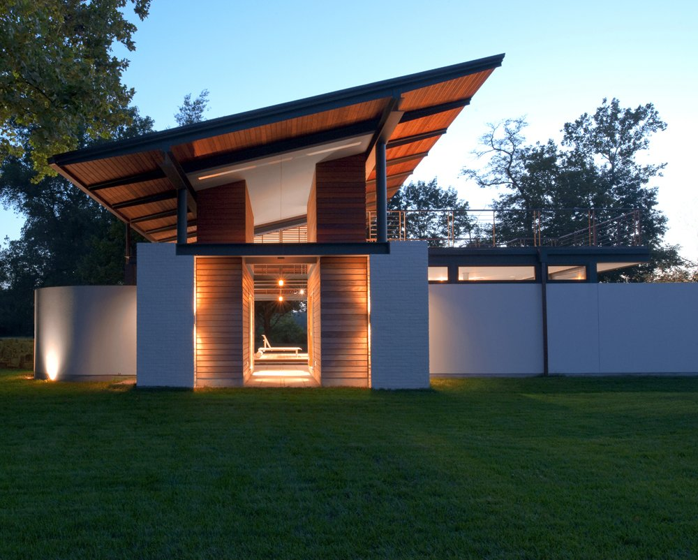Outdoor, Side Yard, Front Yard, Back Yard, Field, Rooftop, Small Patio, Porch, Deck, Large Patio, Porch, Deck, Wood Patio, Porch, Deck, Landscape Lighting, Decking Patio, Porch, Deck, and Hanging Lighting The view at night.  A Summer House