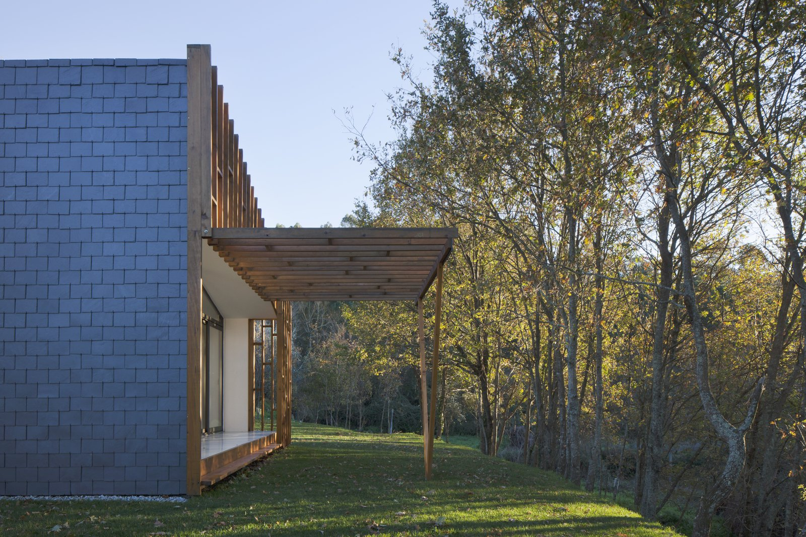 Outdoor, Back Yard, Garden, Trees, Woodland, Grass, Wood Patio, Porch, Deck, Concrete Patio, Porch, Deck, Shrubs, and Stone Patio, Porch, Deck Backyard View  GOMOS #1