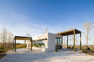 This project by Studio Saxe elegantly combines modern methods of construction with local materials and techniques. Villa Saxo is defined by an exoskeleton pergola structure that provides shade over large terraced areas while also creating a frame for the local flora to grow around.