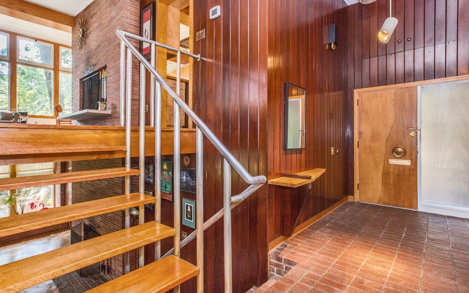 Hallway and Brick Floor Entry Foyer  Classic Mid Century Modern home for sale