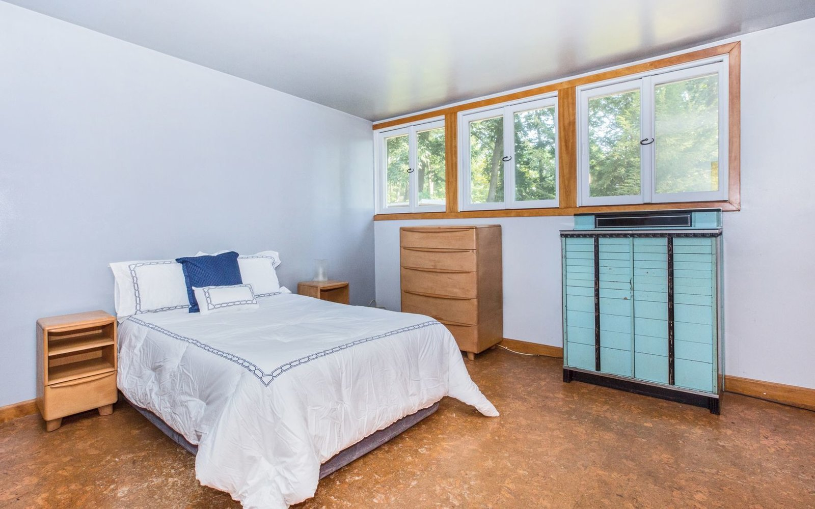 Bedroom, Bed, Dresser, Shelves, Night Stands, Accent Lighting, Storage, Ceiling Lighting, and Cork Floor Bedroom 1  Classic Mid Century Modern home for sale
