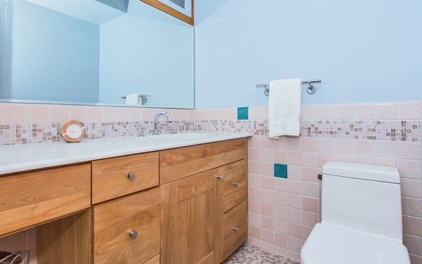Bath Room, Ceramic Tile Floor, Engineered Quartz Counter, Ceiling Lighting, Wall Lighting, One Piece Toilet, and Ceramic Tile Wall European Style Baths  Classic Mid Century Modern home for sale