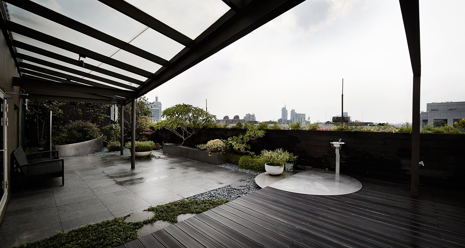 Outdoor, Rooftop, Grass, Garden, Flowers, Trees, Gardens, Stone, Vegetables, Wood, Wood, and Hanging The glazed canopy extends to the garden to shield against the rain, ease the sunshine but does not degrade the light quality in the inner space.  Best Outdoor Rooftop Wood Photos from Sky Villa