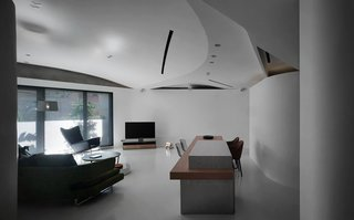 The ceiling is a composite of several curved surfaces, the seams of which implicitly implying the activities underneath.
