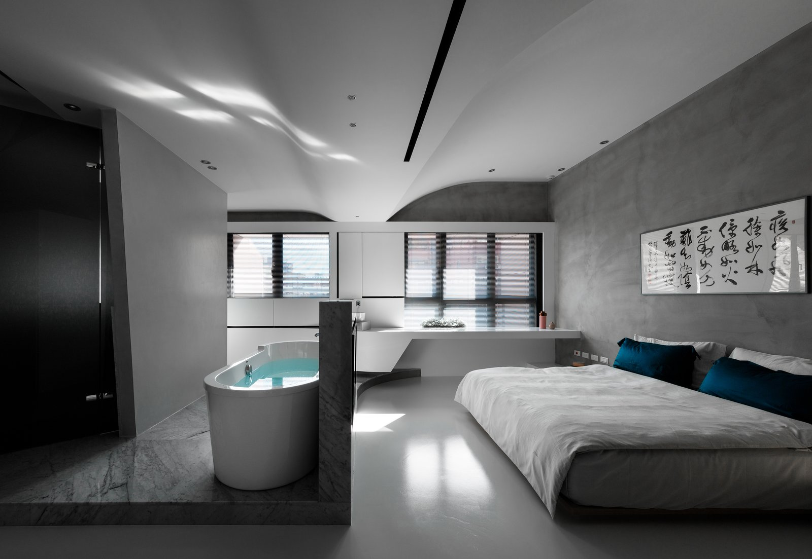 Bedroom, Ceiling Lighting, Marble Floor, Bed, and Concrete Floor The bathtub splits from the bathroom and is separately located in the middle, diverting the circulation around it.  Fluid House