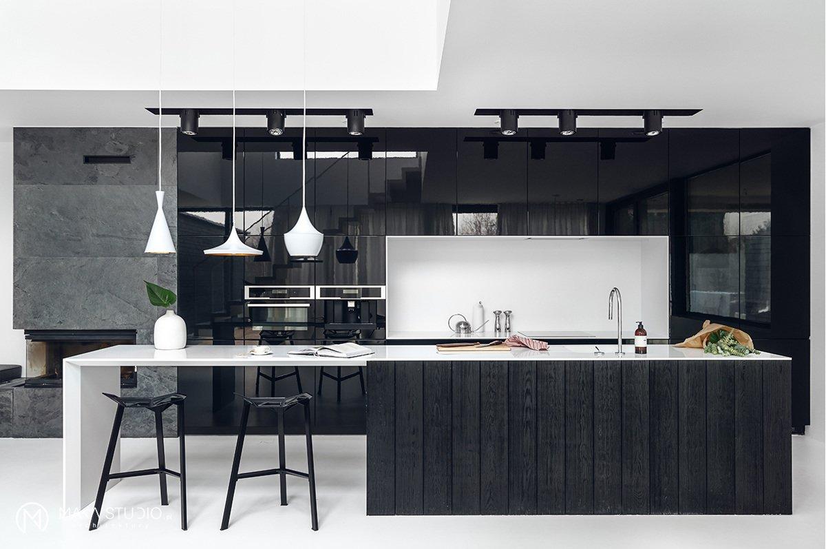 Kitchen, Stone Slab Backsplashe, Track Lighting, Stone Counter, Pendant Lighting, Ceiling Lighting, Wall Oven, and Drop In Sink kitchen  Minimal Seaside Villa
