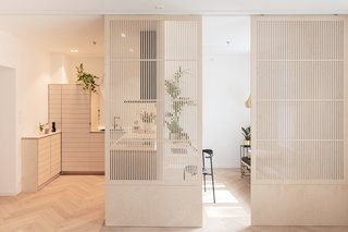 Sliding door separating the rooms. The heart of the living room. The japanese inspired sliding doors acts fully flexible as room divider. When having guest it can be fully closed and for full privacy a curtain is available. Kitchen can also be closed and noise cancelling when cooking, or fully closed during messy days.