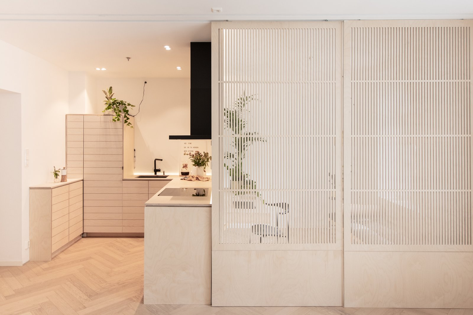 Kitchen, Undermount Sink, Wood Counter, Dishwasher, Ceiling Lighting, Medium Hardwood Floor, Refrigerator, and Wood Cabinet Closed bedroom for full privacy. Sound and light proof curtains can be available inside.  Scandinavian/Japanese concept home in Oslo city center