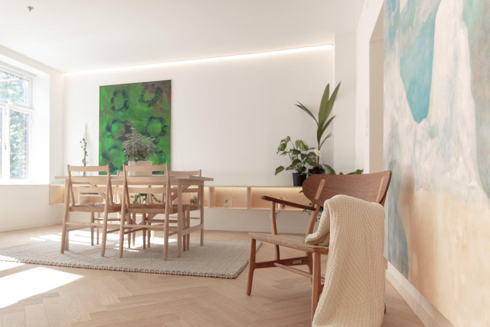 Living Room, Medium Hardwood Floor, Ceiling Lighting, and Chair Living room  Scandinavian/Japanese concept home in Oslo city center