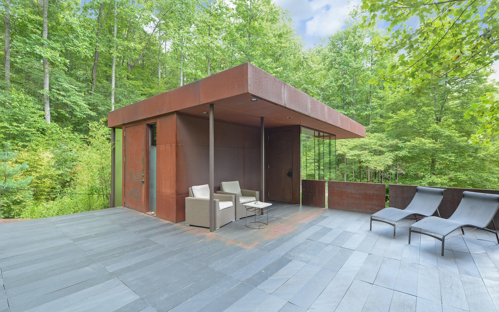 Rooftop, Metal Patio, Porch, Deck, Stone Patio, Porch, Deck, Metal Fences, Wall, Exterior, Metal Roof Material, and Metal Siding Material 'Tree House' - Terrace  Mountain House Modern