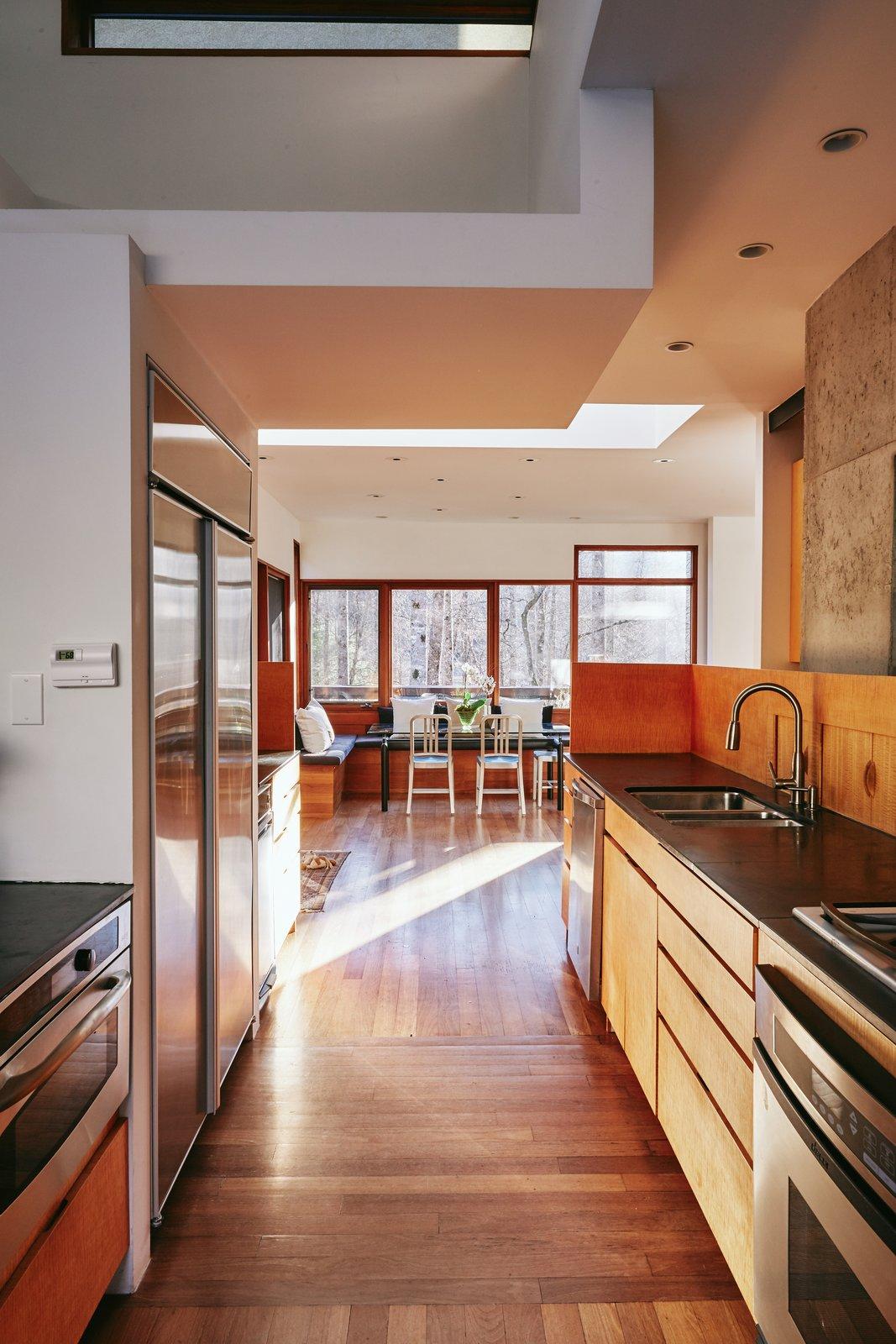 Kitchen, Wood Cabinet, Medium Hardwood Floor, Refrigerator, Undermount Sink, Stone Counter, Recessed Lighting, and Ceiling Lighting 'Mountain House' - Kitchen Natural Light  Mountain House Modern