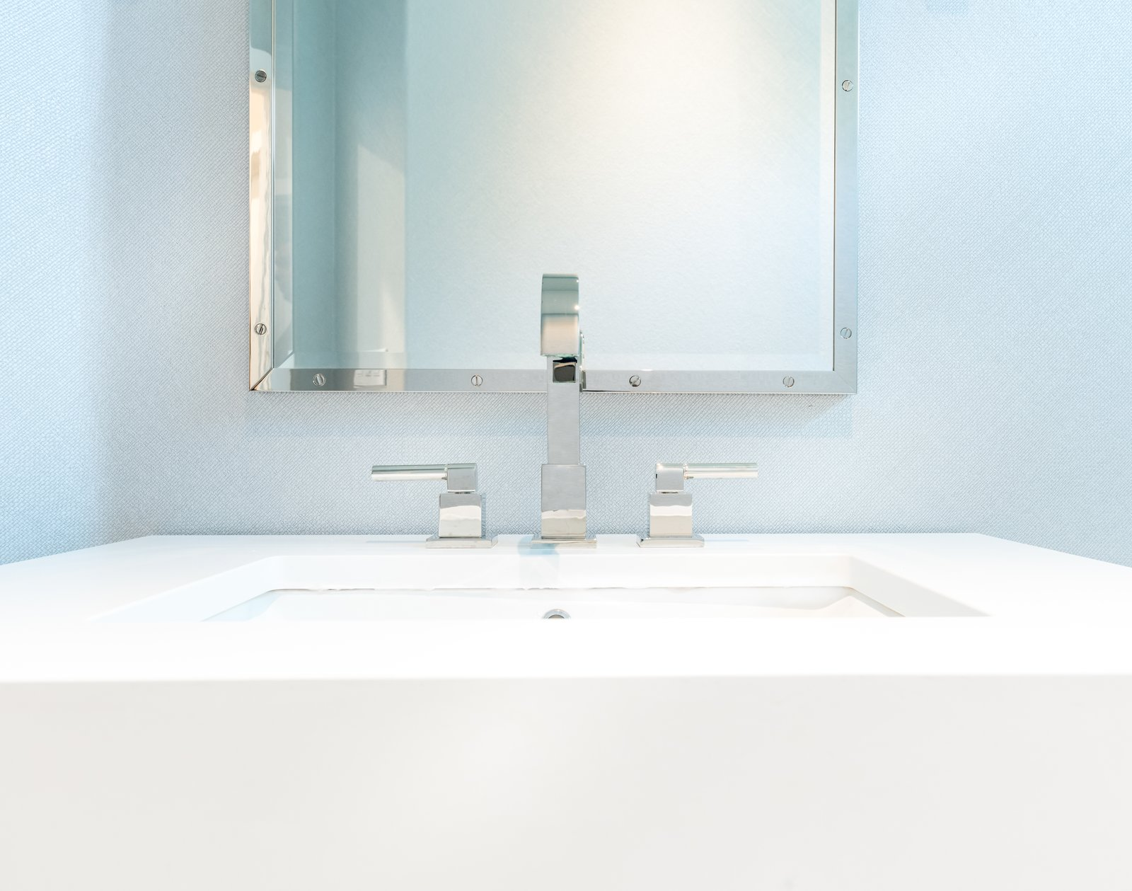 'Pure White' Quartz sink Tagged: Bath Room, Engineered Quartz Counter, Porcelain Tile Floor, Undermount Sink, Enclosed Shower, Ceiling Lighting, and Wall Lighting.  Vegas Luxe