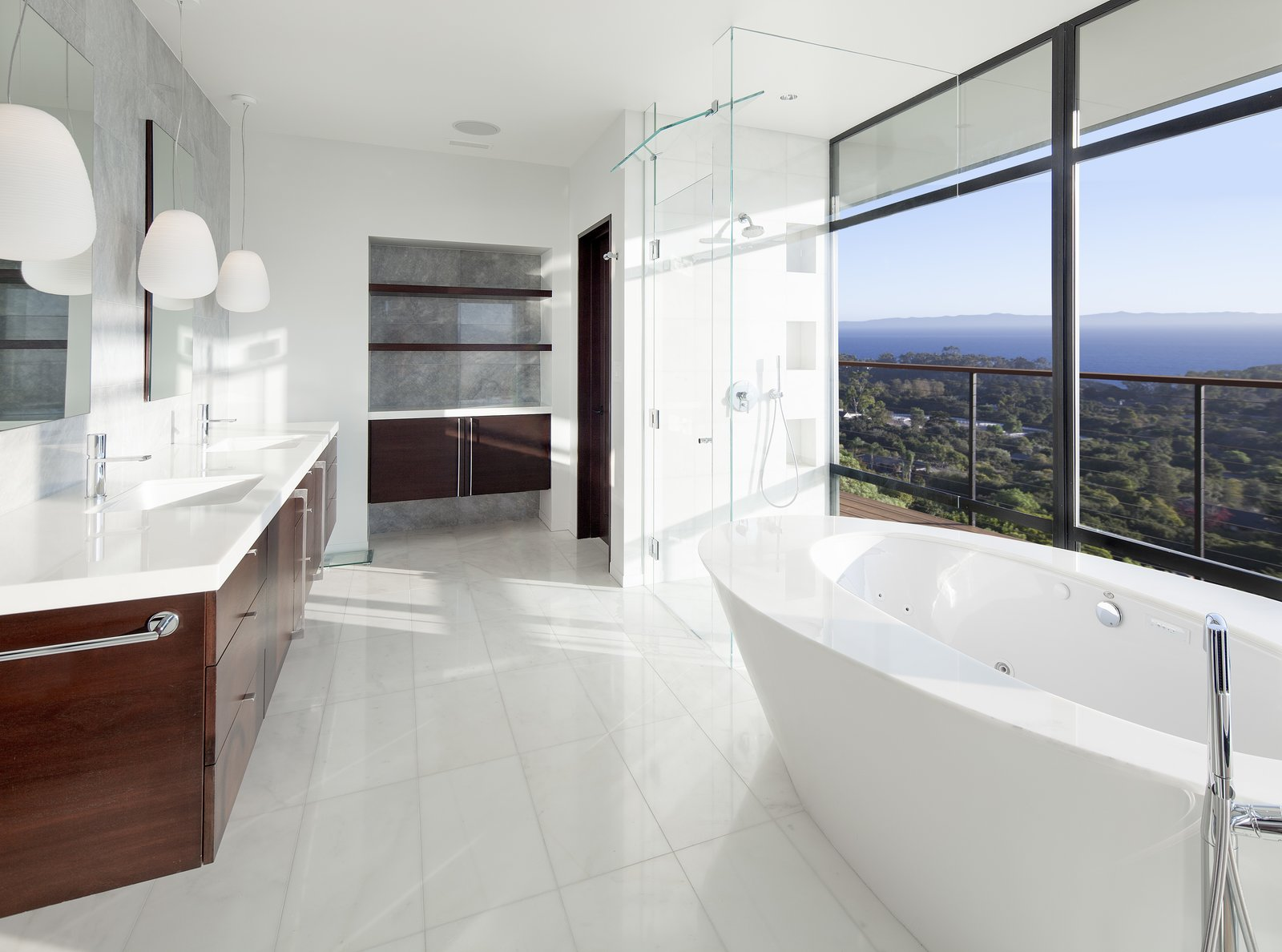 Bath Room, Marble Floor, Pendant Lighting, One Piece Toilet, Marble Counter, Recessed Lighting, Freestanding Tub, Soaking Tub, Whirlpool Tub, Open Shower, and Full Shower Electrochromic glass windows  Best Photos from Hope Ranch Residence