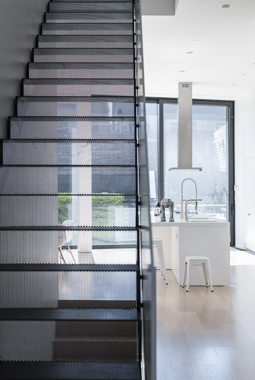 Staircase, Metal Tread, and Metal Railing Main stair made of perforated steel  Mohawk House by UrbanLab