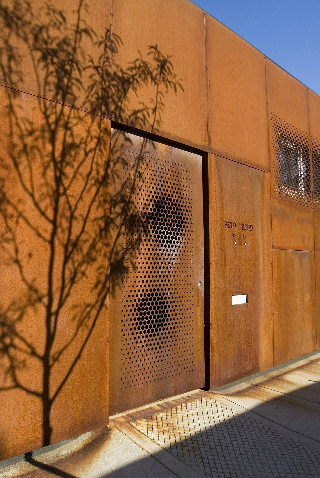 Outdoor, Front Yard, and Trees Facade made with Corten steel  Morgan Street Live/Work by UrbanLab