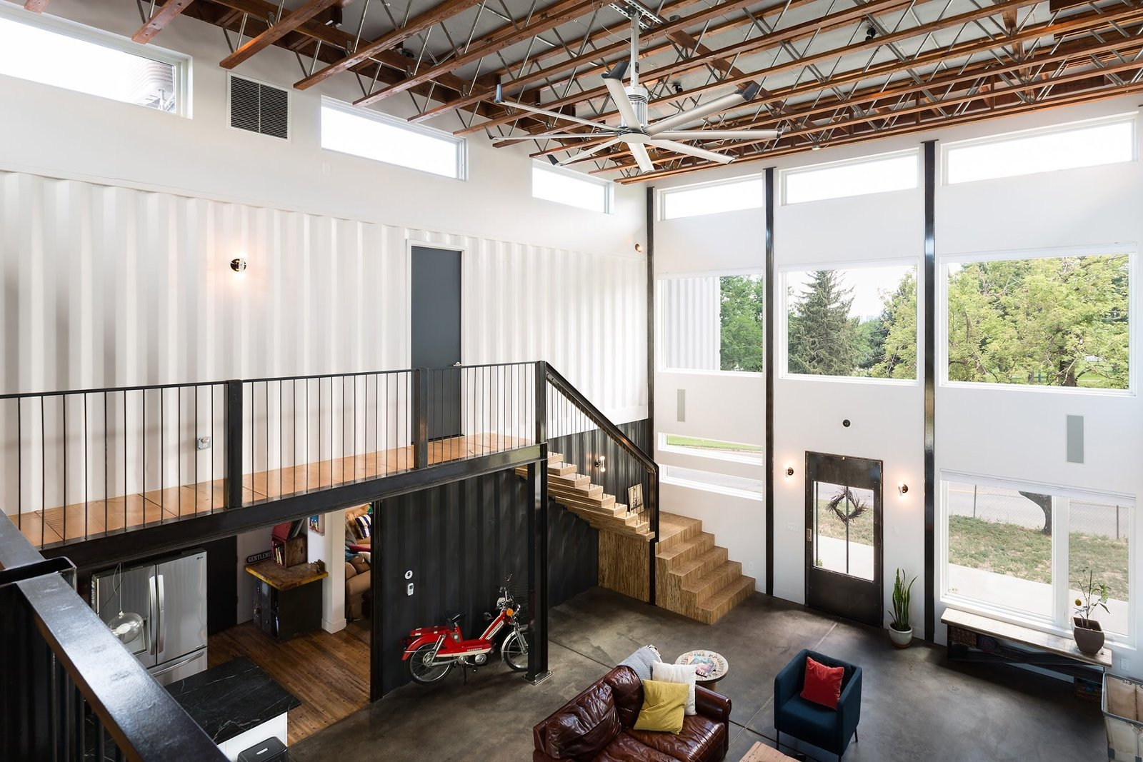Living Room, Chair, Bench, Sofa, End Tables, Ceiling Lighting, Floor Lighting, Table Lighting, and Medium Hardwood Floor Chris Boylen Photography  The Container house