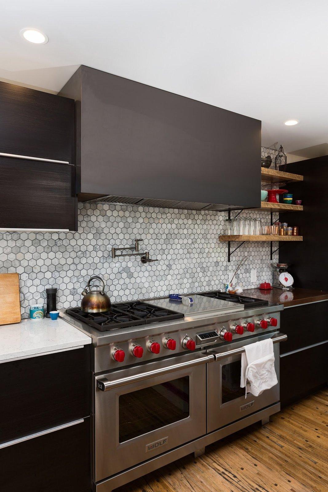 Kitchen, Engineered Quartz Counter, White Cabinet, Wood Cabinet, Stone Tile Backsplashe, Pendant Lighting, Ceiling Lighting, Range, and Range Hood Chris Boylen Photography  The Container house