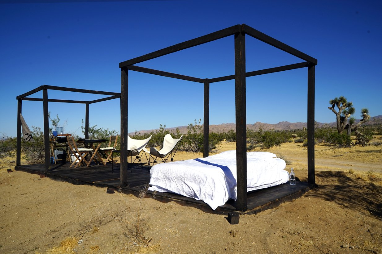 Bedroom and Dark Hardwood Floor Folding wooden cube frames  in convertible mode  Joshua Tree Case Study Cabin by Mike Vensel