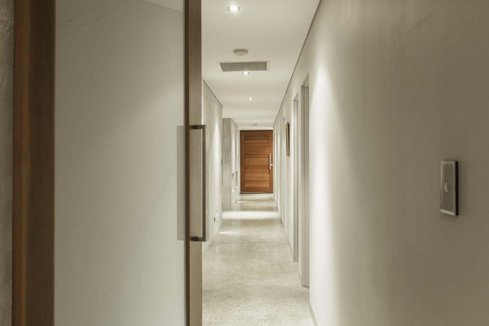 Living Room, Concrete Floor, Ceiling Lighting, and Wall Lighting The Glide zone - mishacks' modular design system.  01 White Shack. by mishack.