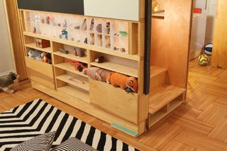 Close-up stair to sleeping loft with storage compartments, including back-lit acrylic display box